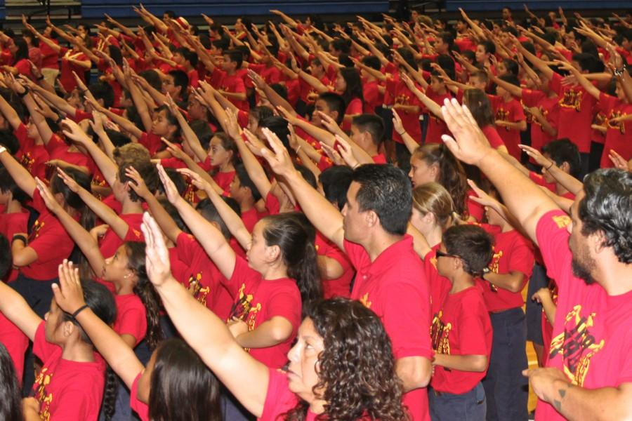 The entire Kamehameha Maui campus, from kindergarten through high school and faculty, hula to Kaulana Nā Pua, the song that set the theme for Red Friday , February 6, 2015. After a day of workshops and instructions, students gathered in Kaʻulaheanuiokamoku for the mass hula and kanikapila.