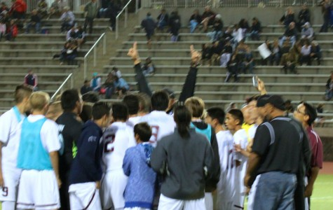 Coach Kane Pelezzotto raises his arms in celebration of the Bears 1-0 win over King Kekaulike at the MIL Division 1 Boys Soccer playoffs, Wednesday, February 11, at Kanaʻiaupuni Stadium. Baldwin advances to the state tournament, which begins next Friday, February 20.