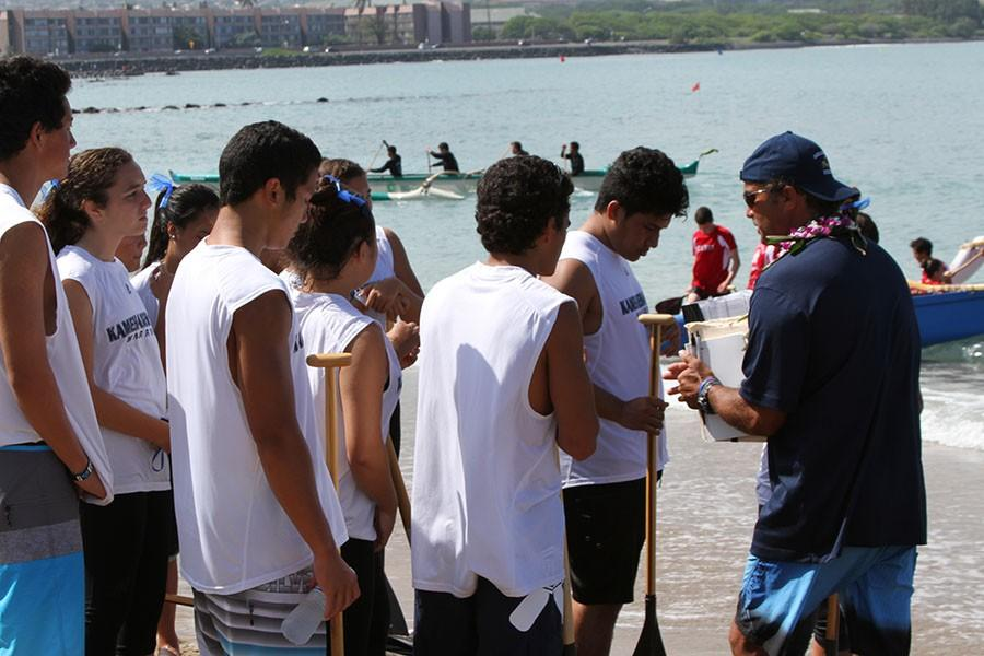 Coach Robert Brede talks to the Varsity Boys I crew before their race at Kahului Harbor on January 31, 2015.