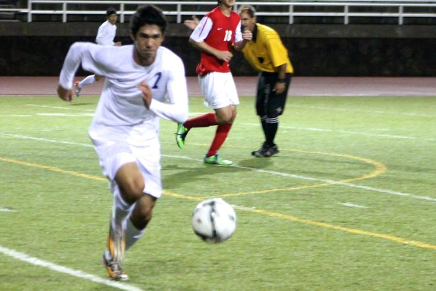 Nainoa Silva sprints after the ball in the February 3 boys soccer game against the Seabury Hall Spartans. The Maui Warriors won, 4-0, on their home turf and on their senior night.