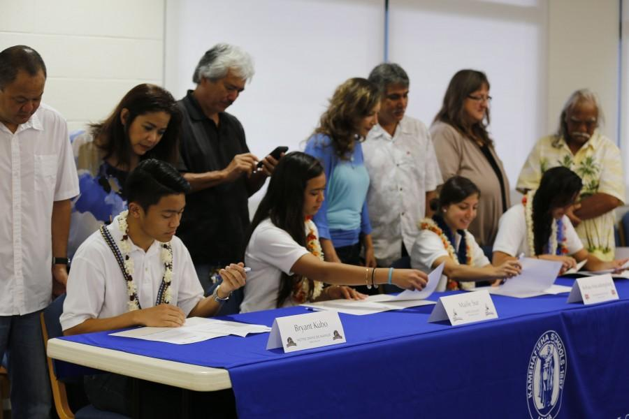 Soccer+seniors+Bryant+Kubo%2C+Maile+Sur%2C+Kehaulani+Macadangdang%2C+and+Noelani+Reyes+signed+their+Letters+of+Intent+Wednesday+February+4+at+the+Charles+Reed+Bishop+Learning+Center.