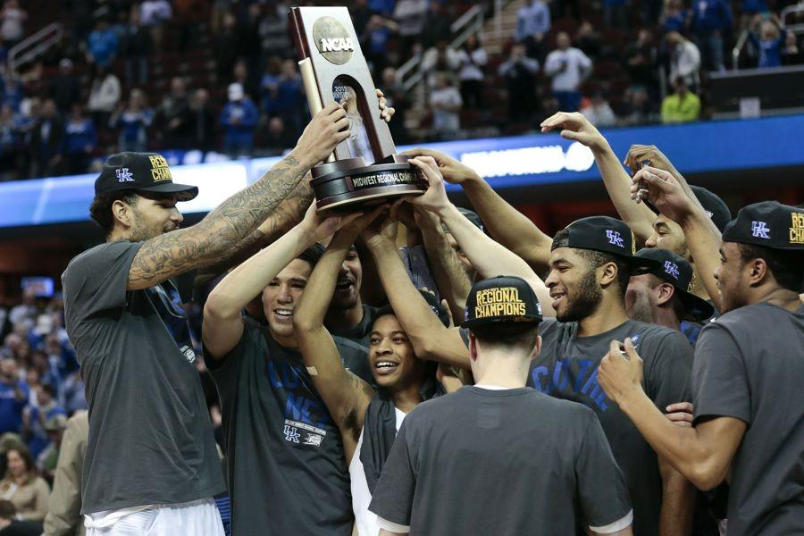 University+of+Kentucky+players+celebrate+with+the+trophy+after+defeating+Notre+Dame%2C+68-66%2C+in+the+NCAA+Tournaments+Elite+8+on+Saturday%2C+March+28%2C+2015%2C+at+Quicken+Loans+Arena+in+Cleveland.+%28Charles+Bertram%2FLexington+Herald-Leader%2FTNS%29