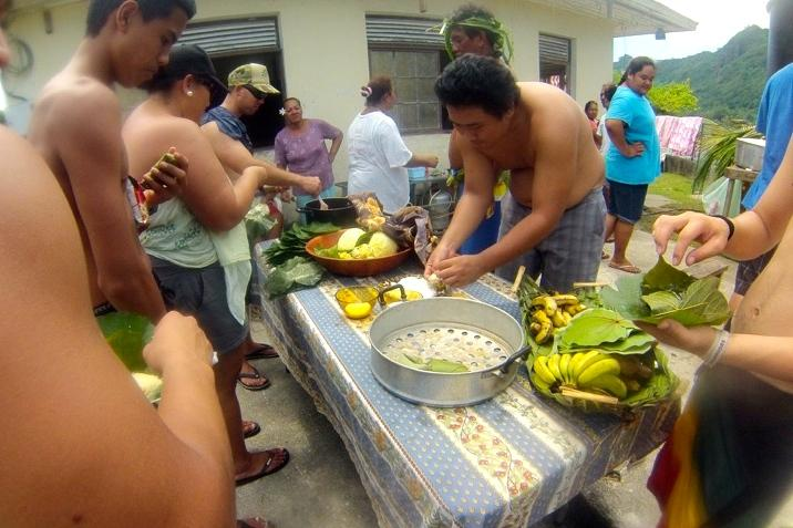 Tahitian hosts prepare a meal for Hawaiian Ensemble students who were visiting over Spring Break. The Hawaiian students toured several islands and toured and performed at Samuel Raapoto School as part of a Spring Break cultural exchange.