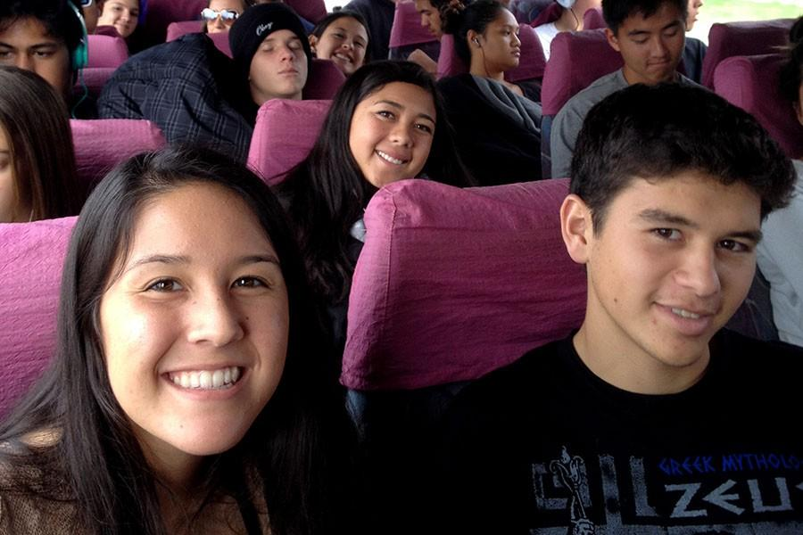 Tynell Ornellas (left), Aeris Joseph-Takeshita, and Kiaku Naeʻole are all-smiles on a bus in Europe. Forty-two traveled to five countries over nine days on the annual school trip to Europe, March 18-27, 2015.