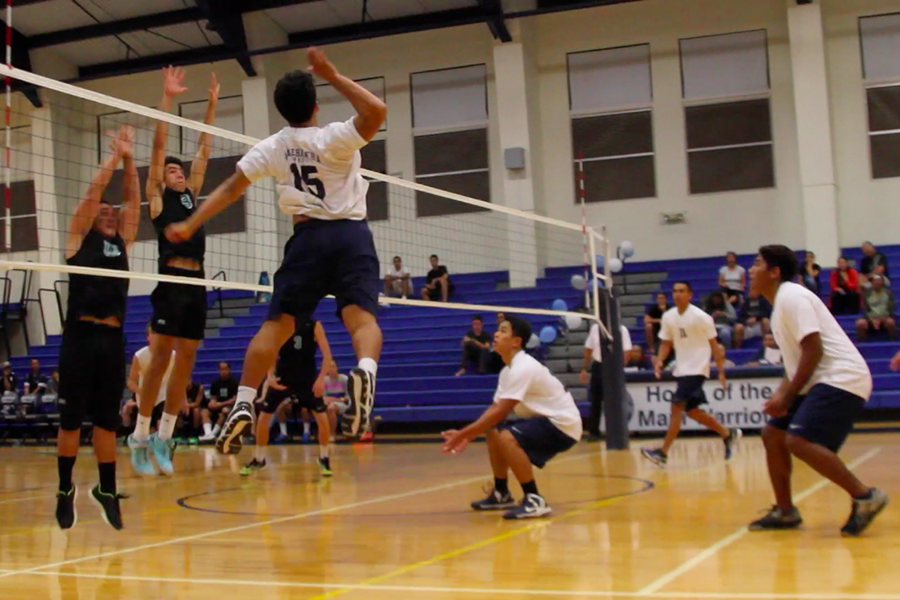 Senior Ionatana Tua gets a kill against King Kekaulike during their 3-1 loss on Tuesday, April 14, 2015, at Kaʻulaheanuiokamoku Gymansium.