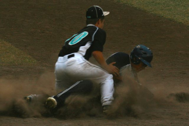 Kulana-Alika Wilhelm raises dust as he makes it home and scores a point for the Warriors at the last game of the season on April 10, 2015 at Maehara Stadium. The game was against King Kekaulike High School and ended with a 13-10 win for Nā Aliʻi.