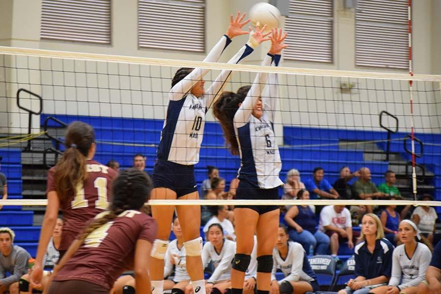 Kanilea Nomura (10) and Talia Leauanae (6) simultaneously block a spike during their Saturday match against West Torrance High School. The 6th Annual Kamehameha Maui Volleyball Invitational started on Thursday August 20 and continued to Saturday August 23. The Kamehameha Maui team placed fifth overall.