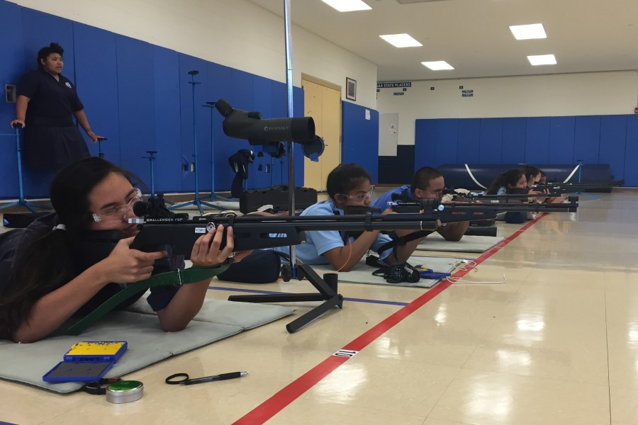 The team practices for their upcoming postal shoot (Wednesday) on Monday, August 24 in the air riflery/ wrestling room.