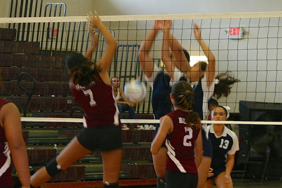 Cheyanne Yap and Tayler Lee get a roof over the Baldwin Bears, Friday, August 28, at the Baldwin gymnasium. The Warriors won three sets to none before it was time for the varsity game.
