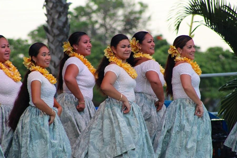 Hula dancers enthrall the audience while Kealii Reichel serenades them, at the Hawaiian Music Festival at Maui Tropical Plantation on September 6, 2015.