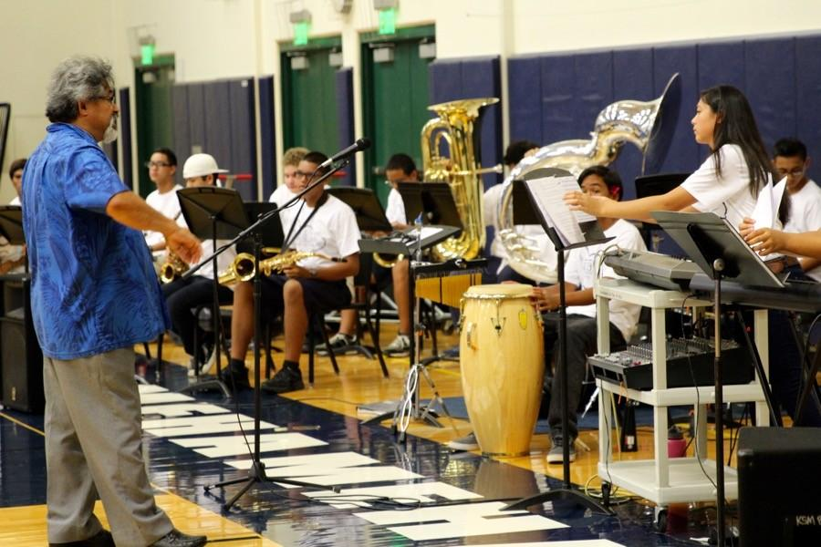 Jazz%2FRock+Ensemble+sets+up+and+practices+before+the+pep+rally+begins%2C+at+the+high+school+gym+on+Sept.+18%2C+2015.