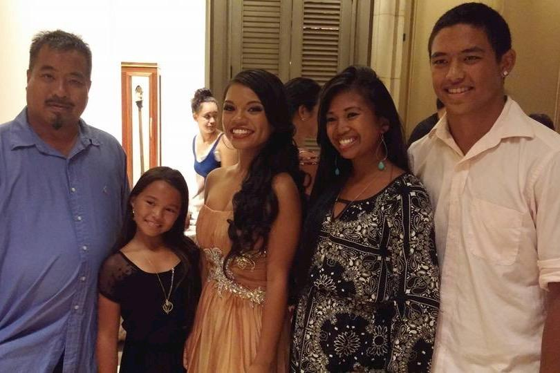 Sophomore Gabrielle Constantino (middle) celebrates with her family during the Miss Maui's Outstanding Teen pageant Oct. 17 in Wailea. She won the title of Miss Aloha Valley Isle Outstanding Teen.