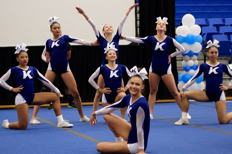The Warriors Varsity Squad gives their final pose in their routine. In the middle (on the ground) is Hannah Patrick, one of the captains on the squad. The competition took place at the KSM high school gym, on November 7, 2015.