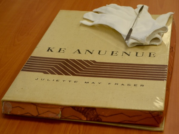 In efforts to preserve Ke Anuenue, wearing gloves and using a tool to flip the pages are required.