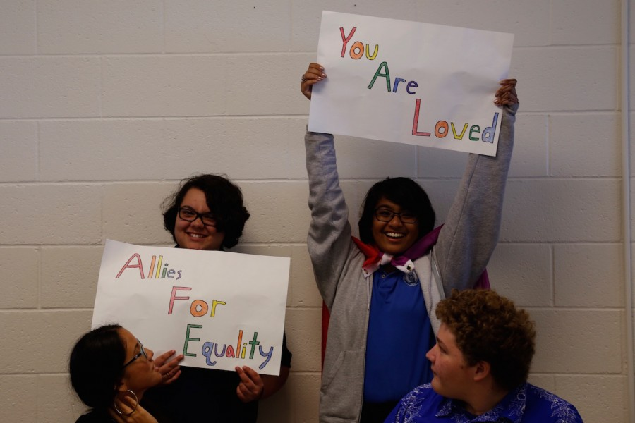 Juniors Anela Brittain and Raven Yamamoto advertise for the Allies for Equality Club during club sign-ups day. The club promotes the acceptance of all people and combats issues like bullying. Its members participate in activities that help others, raise awareness, and spread love to all.