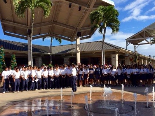 The freshmen line up in front of the performance stage to sing to shoppers at the Maui Mall.