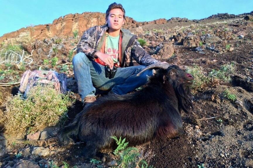 Senior Noah Monte displays the goat he took down on a hunting expedition in PoliPoli. He waited about four hours until a herd of goats came into the gulch he was hiding in, and used a Ruger .270 rifle to get the kill.
