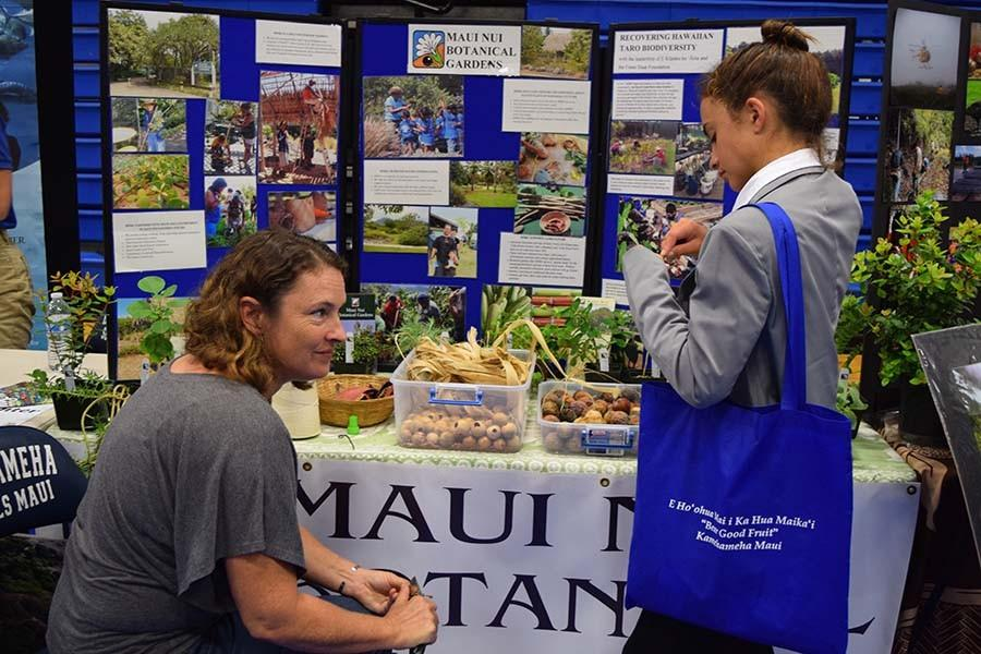 Sophomore Lily Gavagan the Maui Nui Botanical Gardens booth during the 2015 Career Fair. This was one of more than 30 live exhibits in the gym expo, held as part of an entire school day focused on careers.