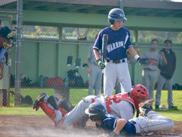 Jace Baqui tries to steal home while Dana Bui is up to bat, but the referee called him out. The Maui Warriors lost to the Lahaina Lunas, 5-3, on Wednesday, Feb. 10, 2016, in their last game of the season.