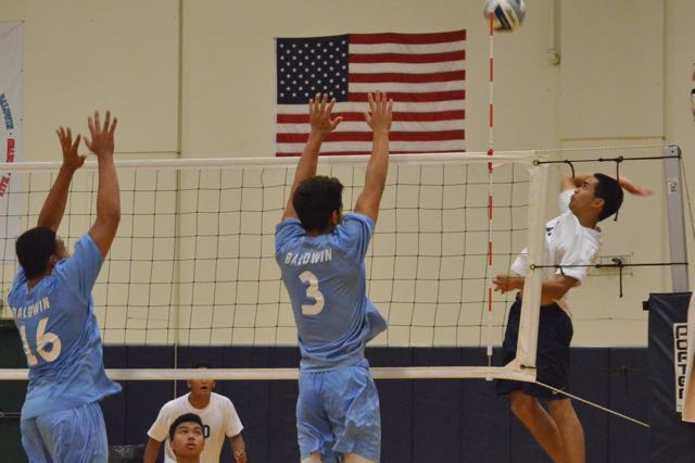 Senior Craden Kailiehu goes to slam the ball past Baldwin on Saturday, March 5 at Kaʻulaheanuiokamoku Gymnasium. The Warriors won their first match-up with the Bears, 3-0.