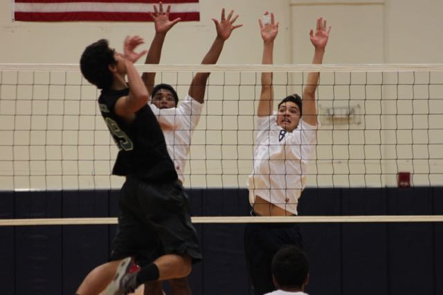 Hanalei Hoopai-Sylva and Hanalei Alapai block King Kekaulikeʻs Nakuluai Morando during their game on Wednesday, March 9, at Kaʻulaheanuiokamoku Gymnasium. Nā Aliʻi won the game, 3-0.