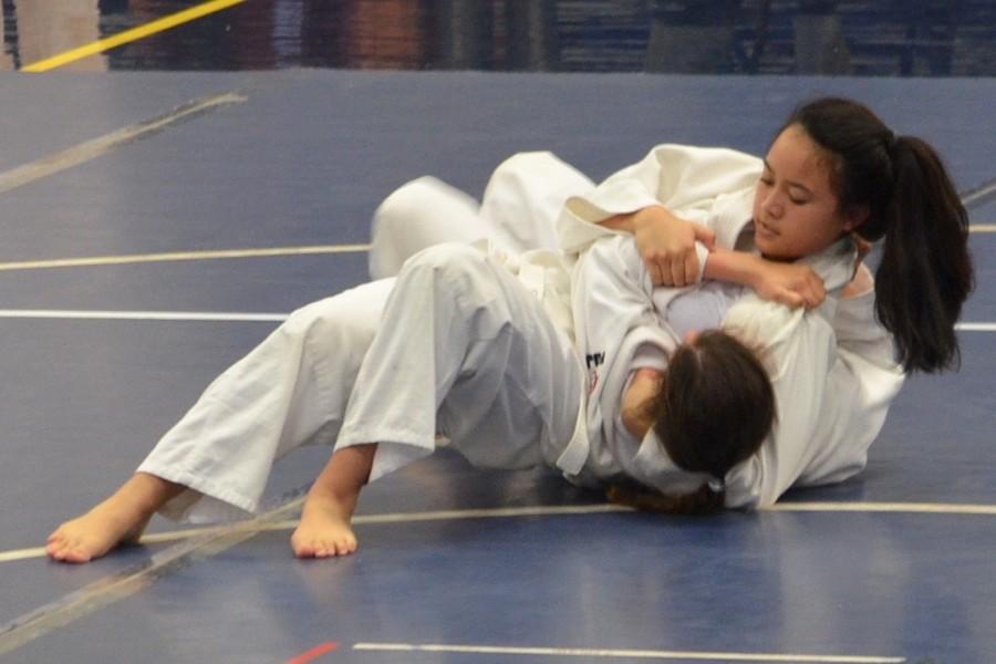 Freshman+Taylor+Watanabe+pins+her+opponent.
