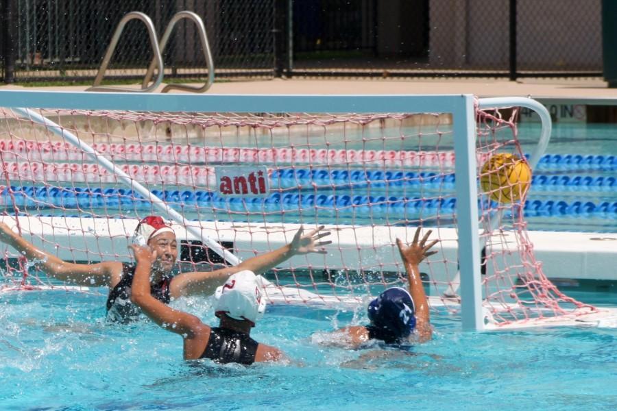 Lahainaluna%27s+goalie+reaches+for+a+shot+thrown+by+Quinn+Shiraishi.
