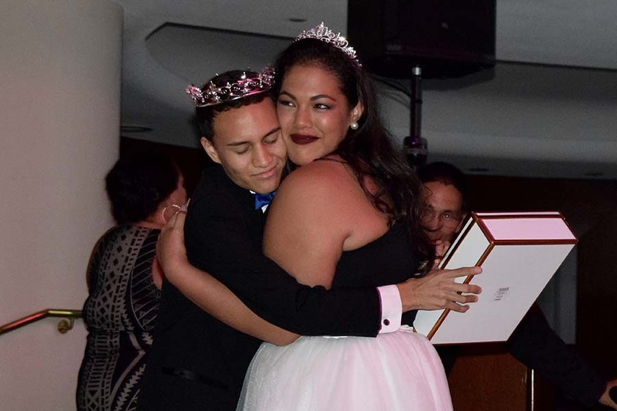 Kupono Aguirre and Kortney Russell share a hug after being crowned prom king and queen Saturday, April 30.
