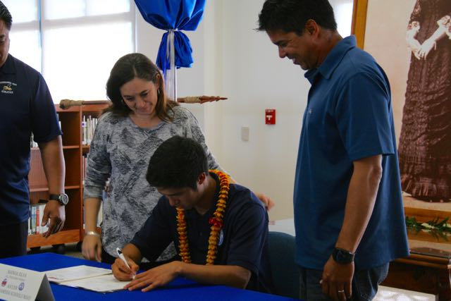 Nainoa Silva with parents Tanya and Jeff Silva, signing his National Letter of Intent to Colorado State University- Pueblo to play soccer on Wednesday, May 4 in the Charles Reed Bishop learning center.