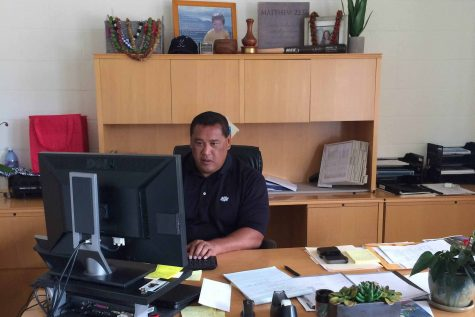 Coach Jon Viela, the new athletic director, settles into his office in the athletics department. He brings with him a desire to instill a the value of pono in Warrior student-athletes.