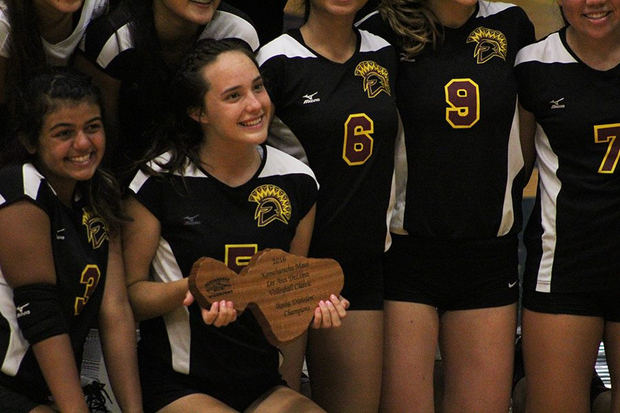 Oʻahu's Maryknoll High School girls volleyball proudly displays their first place trophy at the 2016 Lee Ann DeLima Volleyball Classic, Aug. 18-20, at Kamehameha Maui. The Spartans won all seven of their games over the 3-day tournament to emerge the winners.