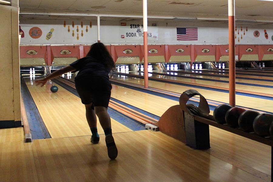 Junior Ashley Taylor Peralta picks up a spare at the bowling match against Baldwin High School, Saturday, Sept. 24, at Maui Bowling Center. Both boys and girls Maui Warriors won and remained undefeated so far in the season.