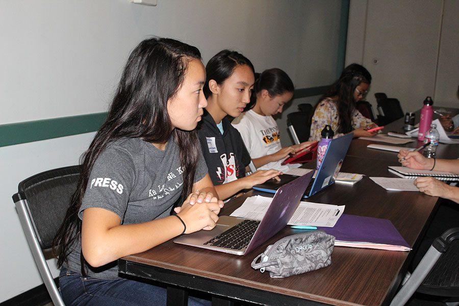 Staff writer Riann Fujihara as she pays attention to her instructor while working on her opinion article on proposed motor-voter registration.