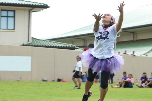 Ms.+Chong+springs+up+to+catch+one+of+the+kicked+balls+from+the+seniors+at+their+friendly+game+of+kickball+after+the+student+championships%2C+Friday%2C+Sept.+23.+The+teachers+versus+students+game+finished+off+a+day+of+spirit-building+homecoming+activities.