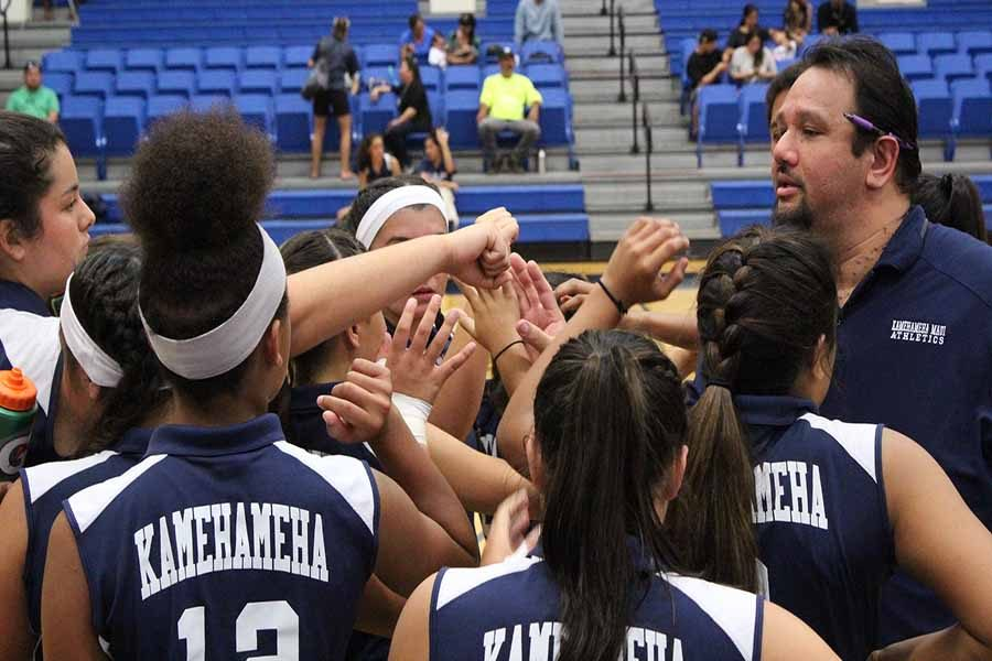 KSM jv girls huddle up with coach Dukie Josiah before Tuesday's game against the Lunas. The Maui Warriors won in three sets.