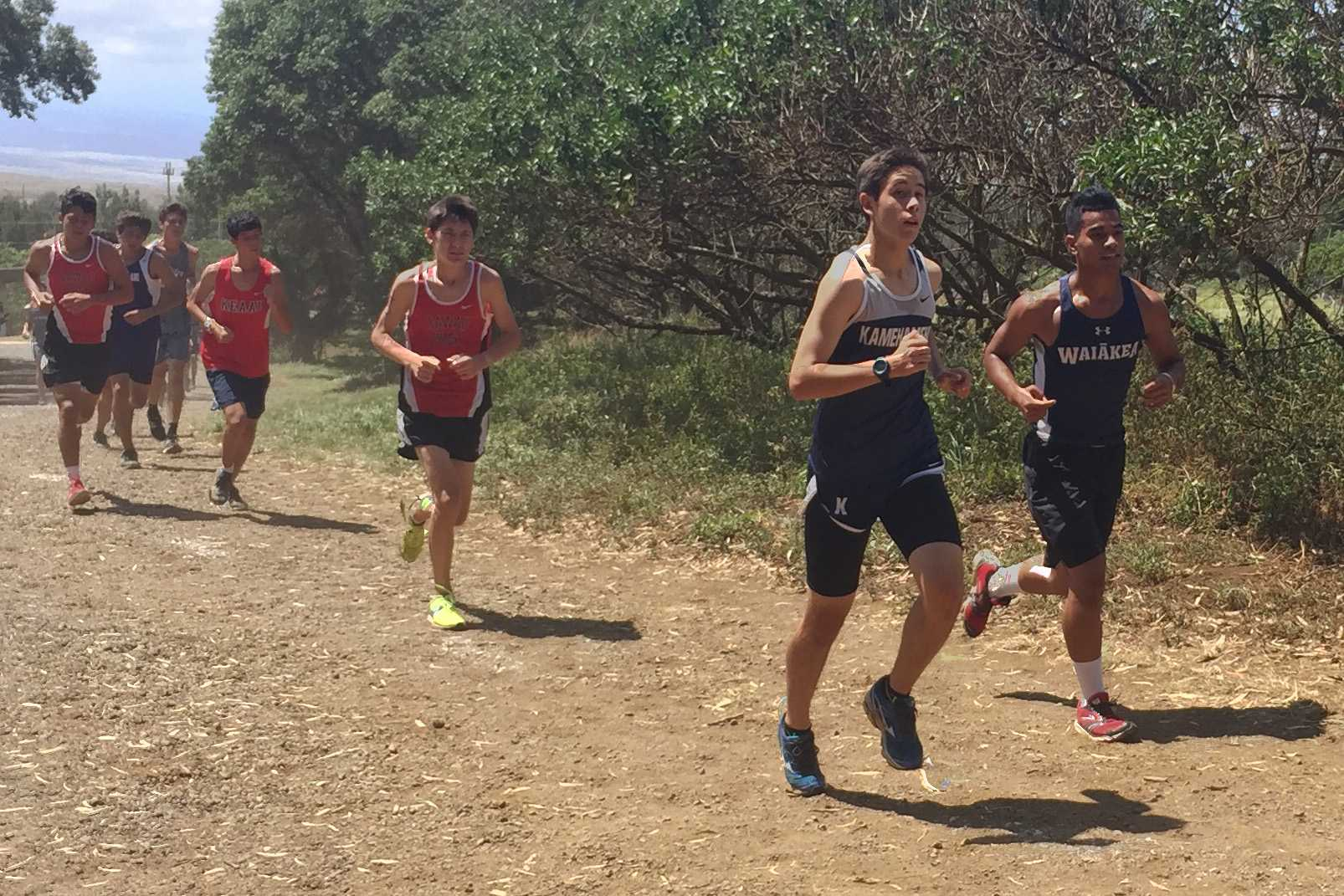 Sophomore Cy Ornellas runs at the HPA invitational meet held on the Big Island, Sept. 24. Athletes from around the state got a try at the state competition course.