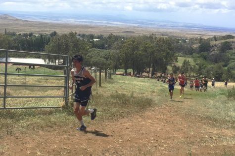 Andrew Amaral tackles the hill, one of the hardest spots of the course.
