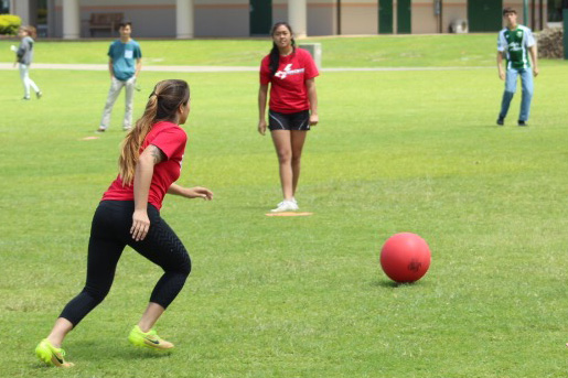 Clara-Josephine Lei Medeiros goes for the shot as she represents the senior class in their game against the freshmen at todays kickball game during lunch. The kickball tournament is part of this weeks homecoming festivities.