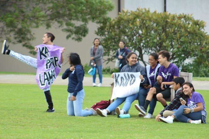 The+junior+class+supports+their+kickball+team+by+holding+up+signs+and+cheering+them+on.