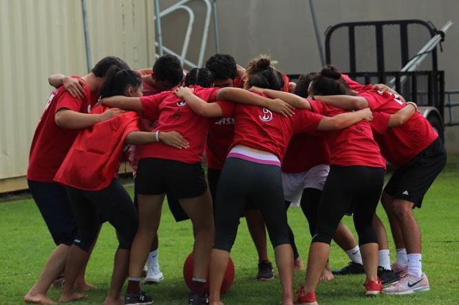 Seniors+huddle+before+the+kickball+championship+to+get+pumped+up+before+the+game.
