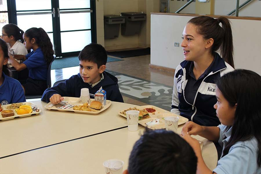 As a member of the Letterman's Club, senior Kiana Correa chats with elementary school students at lunch on Friday, Sept. 16. The club for exceptional student-athletes is hoping to inspire younger students to join Warrior athletics when they get to high school.