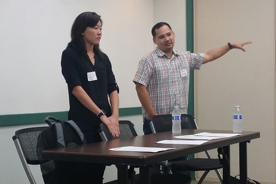 Kim Yuen and Steven Tonthat answering questions after their video presentation during journalism day at University of Hawaiʻi.