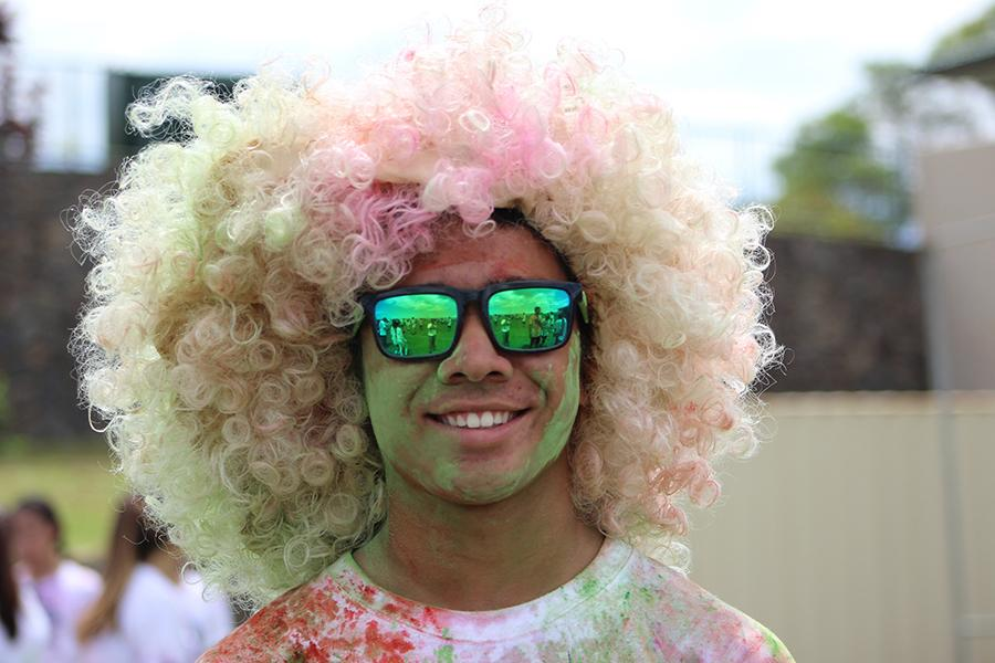 Sophomore Kayden Choda-Kowalski shows his colors after the color run that capped Homecoming Week. The color run, the first to be held at any school in Hawaiʻi, was one of many spirit-building activities prior to the homecoming football game.