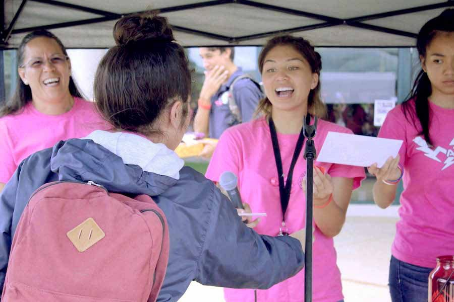 Senior Tatiana-Marie Mendez wins a $10 gift card to Jamba Juice at the fundraising cancer walk hosted by senior Leialoha Medeiros on Wednesday, Sept. 28. Mendez also won one of two grand prizes, a certificate for a paragliding session, later.