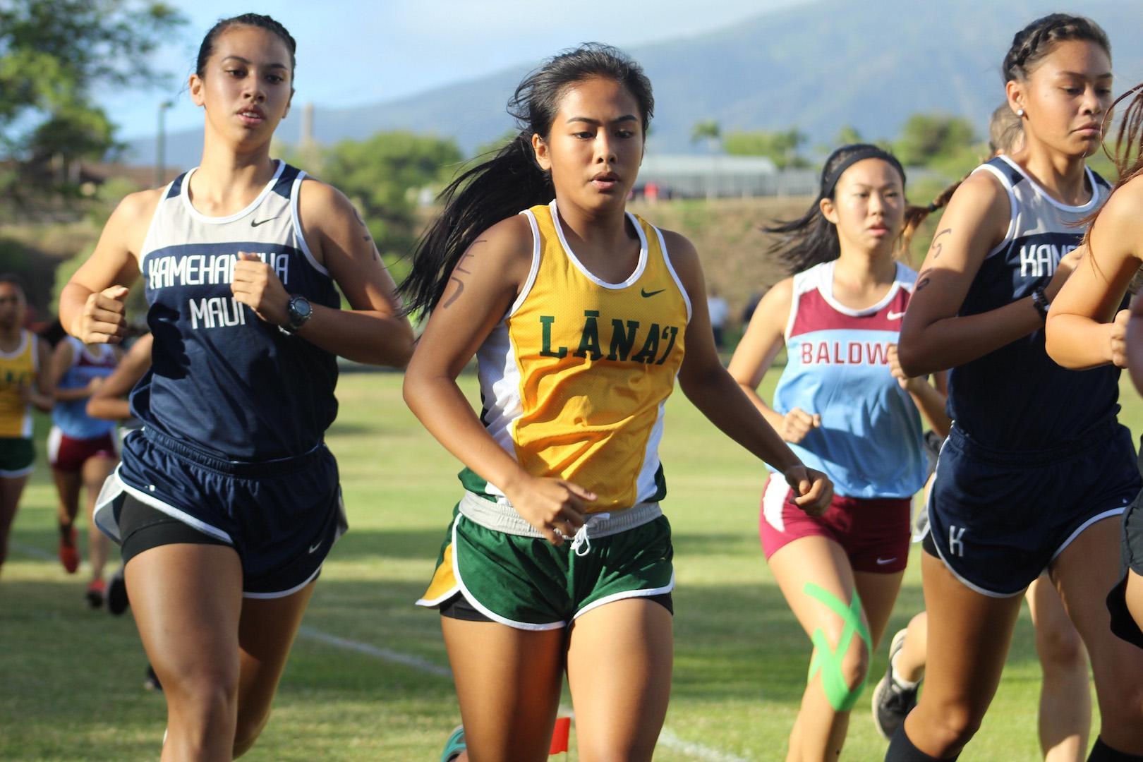 Senior Jasmine Casey begins the 3-mile course of the MIL championship meet with sophomore Keely Logan by her side at KCC park this Saturday. Four KS Maui runners qualified for the state meet.