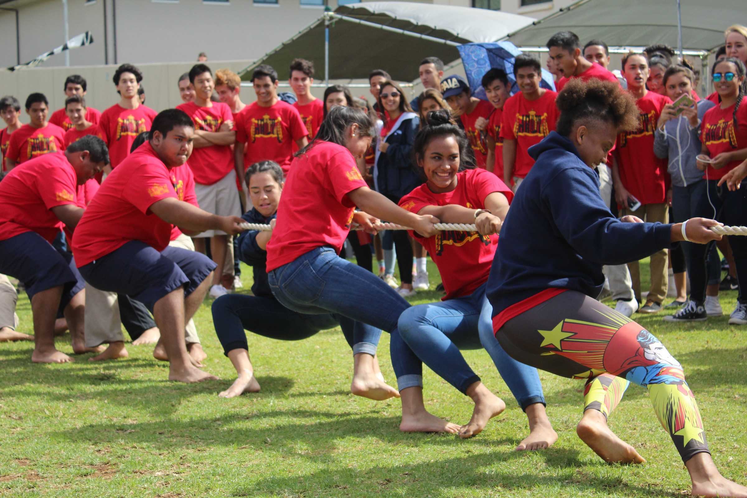 Students dig in during hukihuki. Kamehameha Schools Maui 9th-, 11th- and 12th-grade Warriors gathered at the practice field to compete in Makahiki games throughout Pōʻalima ʻUlaʻula, Oct. 28. Seabury Hall, Molokaʻi High School, and selected KS Scholars also competed in the activities.