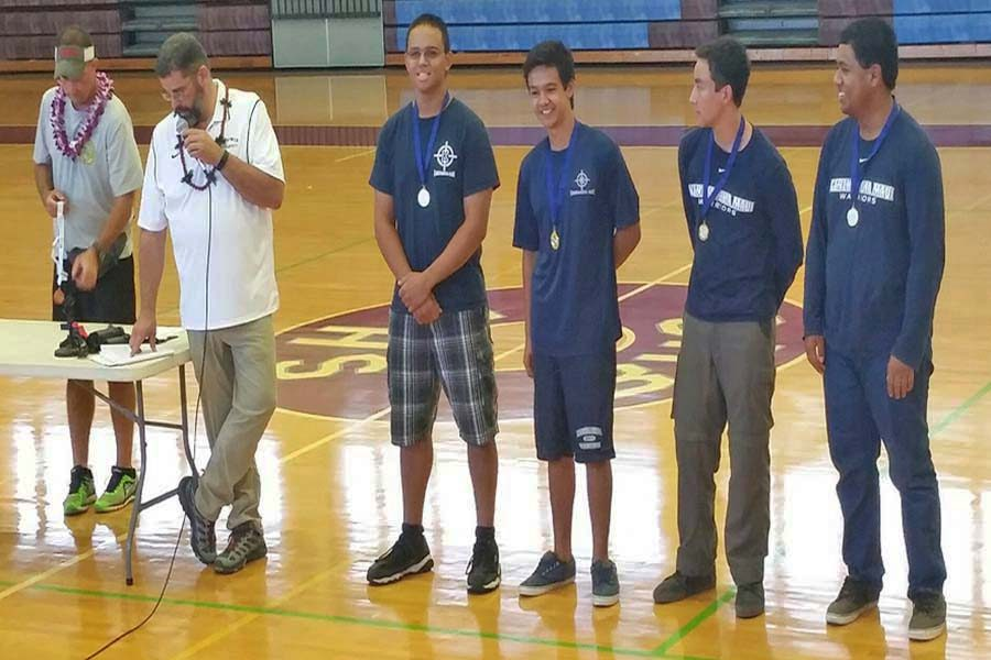 Kody Cambra (10), Jacob Julian (11), Joshua Grant (10) and Cody Tancayo (12) receive medals for top individual standings. The KSM boys riflery team came out victorious as 1st place champions.
