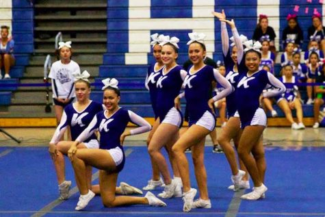 Kamehameha Maui's varsity cheerleading squad strikes a pose at the end of their routine.