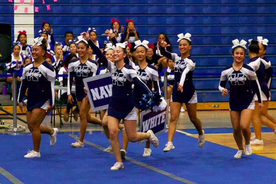 The+junior+varsity+Warriors+show+their+enthusiasm+while+running+toward+the+mat+to+begin+their+exhibition+routine.