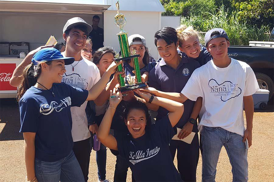 Senior+Quinn+Shiraishi+holds+the+first+place+trophy+up+high+as+she+celebrates+the+Kamehameha+Maui+sweep+of+the+Maui+County+Soil+and+Water+Conservation+Contest+with+her+teammates.